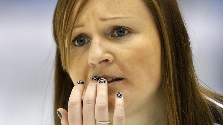 Scotland skip Kerry Barr looks at her shot during her draw against Latvia at the World Women's Curling Championships in St.John