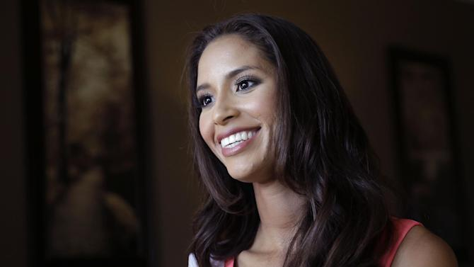 In this Monday, July 6, 2015 photo, Miss Rhode Island Anea Garcia participates in an interview after rehearsals for the upcoming Miss USA Pageant in Baton Rouge, La. Pageant co-owner Donald Trump recently made comments painting Mexican immigrants as criminals. (AP Photo/Gerald Herbert)