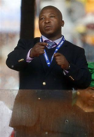 Man passing himself off as a sign language interpreter punches the air during a speech being given by India's President Mukherjee at memorial service for late South African President Mandela in Johannesburg