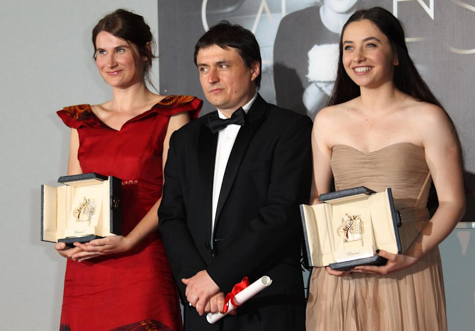 Director Cristian Mungiu, center, and actresses Cristina Flutur, left, and Cosmina Stratan pose with their awards during a photo call for the Best Director and Best Actress award for Beyond the Hills at the 65th international film festival, in Cannes, southern France, Sunday, May 27, 2012. (AP Photo/Joel Ryan)