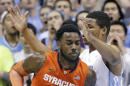 North Carolina's Kennedy Meeks, right, guards Syracuse's Rakeem Christmas (25) during the first half of an NCAA college basketball game in Chapel Hill, N.C., Monday, Jan. 26, 2015. (AP Photo/Gerry Broome)