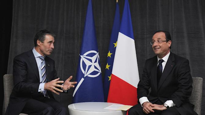 French President Francois Hollande, right, meets with NATO Secretary General Anders Fogh Rasmussen  during a bilateral meeting at Radisson Blu Hotel before attending the opening session of the NATO Summit in Chicago, Sunday, May 20, 2012. (AP Photo/Yoan Valat, Pool)