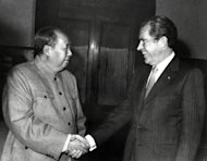Chinese leader Mao Tse-tung (L) shake hands with Richard Nixon in Beijing on February 22, 1972 during the US President's official visit in China. 'Nixon in China', an opera inspired by the first visit to Beijing by a US president, gets a facelift this month in Paris at the hands of Chinese-born director Cheng Shi-Zheng