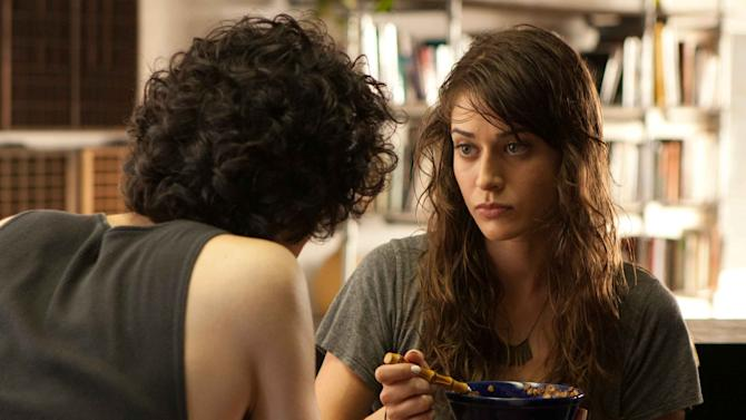 "This film image released by IFC Films shows Lizzy Caplan, right, and Geoffrey Arend in a scene from ""Save the Date."" (AP Photo/IFC Films)"