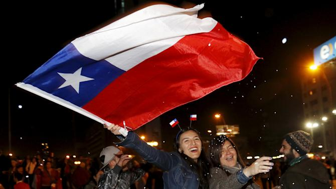 Chilean fans celebrate Chile's victory over Argentina in their Copa America 2015 final soccer match in Santiago
