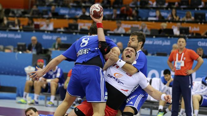 Jurecki of Poland is blocked by Kopljar and Horvat of Croatia during their quarterfinal match of the 24th Men's Handball World Championship in Doha