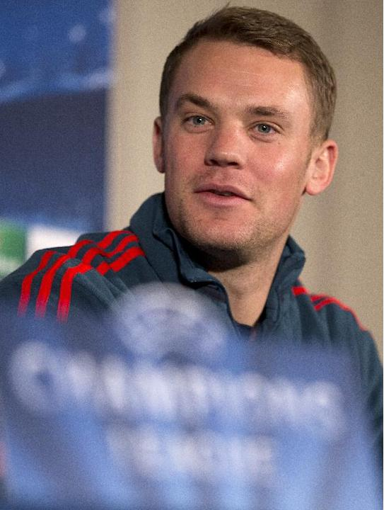 Bayern Munich's goalkeeper Manuel Neuer speaks during a press conference in London, Tuesday, Feb. 18,2014, ahead of their round of 16 Champions League soccer match against Arsenal on Wednesday