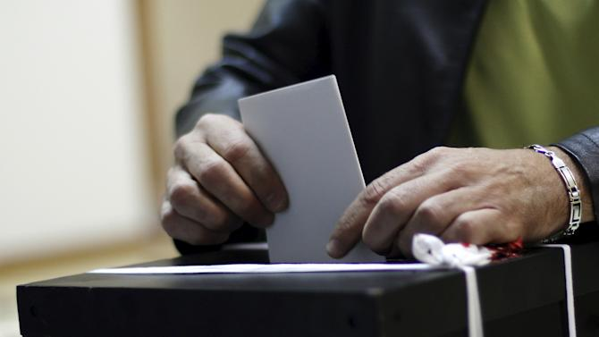 Man casts his ballot during the general election in Massama