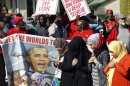 Protesters pray infront of the U.S. embassy during a protest against the visit of U.S. President Barack Obama in Pretoria