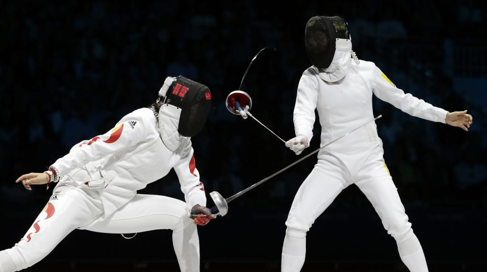 Ukraine's Yana Shemyakina loses her epee as she faces China's Sun Yujie during a women's individual epee fencing semifinals match against at the 2012 Summer Olympics, Monday, July 30, 2012, in London. (AP Photo/Andrew Medichini)