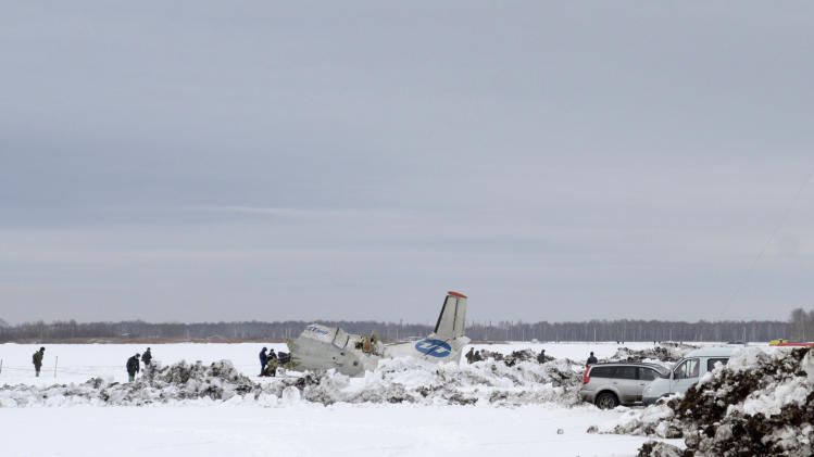 Rescuers search the site of the atr-72 plane crash outside tyumen