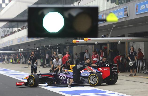 Red Bull Formula One Driver Vettel Has His Car Pushed Back Into