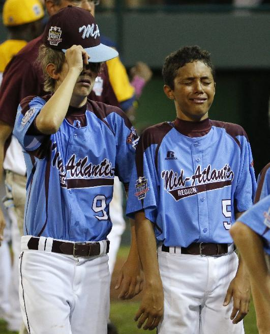 Philadelphia's  Carter Davis (9) and Scott Bondras (5) walk off the field after a 6-5 loss in an elimination baseball game against Chicago at the Little League World Series tournament in South Williamsport, Pa., Thursday, Aug. 21, 2014