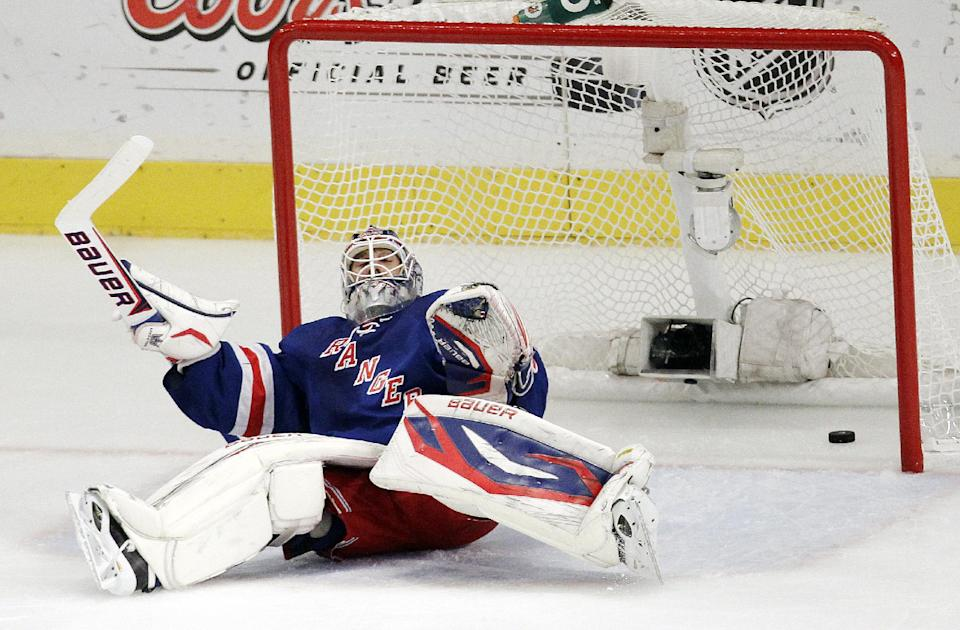A shot by New Jersey Devils' Travis Zajac enters the net behind New York Rangers goalie Henrik Lundqvist, of Sweden, during the first period of Game 5 of an NHL hockey Stanley Cup Eastern Conference final playoff series, Wednesday, May 23, 2012, in New York. (AP Photo/Julio Cortez)