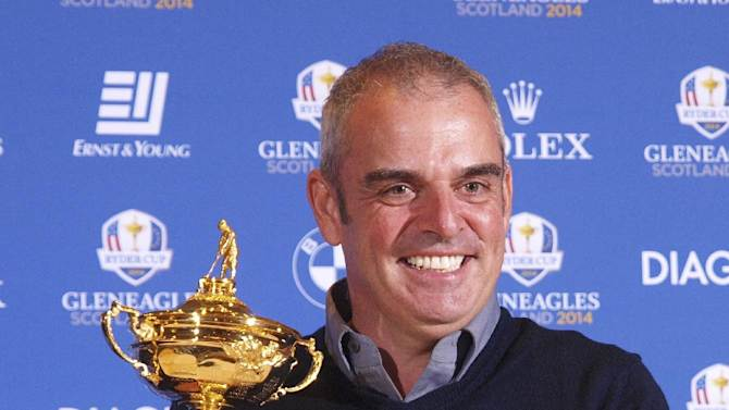 Paul McGinley of Ireland holds the Ryder Cup after being nominated Captain for the 2014 European Ryder Cup Team following a meeting of the Tournament Committee of the European Tour in Abu Dhabi, United Arab Emirates, Tuesday, Jan. 15, 2013. (AP Photo/Manuel Salazar)