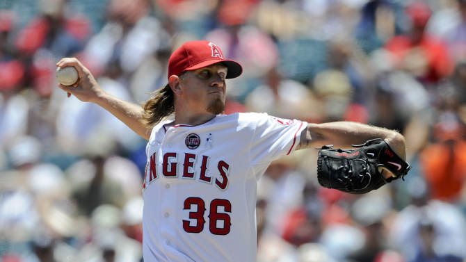 Los Angeles Angels starting pitcher Jered Weaver throws to the New York Yankees during the first inning of a baseball game in Anaheim, Calif., Sunday, June 16, 2013. (AP Photo/Chris Carlson)
