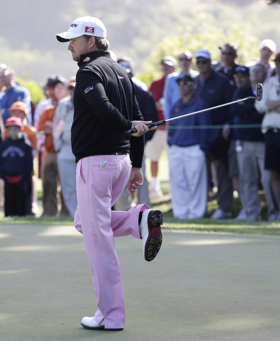 Graeme McDowell, of Northern Ireland, reacts to a putt on the 14th hole during the second round of the U.S. Open Championship golf tournament Friday, June 15, 2012, at The Olympic Club in San Francisco. (AP Photo/Eric Gay)