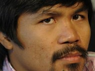World boxing champion Manny Pacquiao, seen here in February 2012, says a growing row with the Philippine government over tax will not distract him for his Las Vegas showdown with the undefeated Timothy Bradley