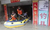China Floods: Storms Leave Hundreds Trapped