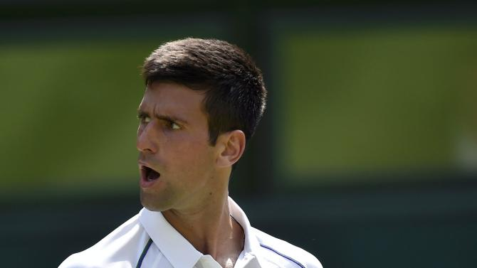 Novak Djokovic of Serbia reacts to breaking serve during his match against Jarkko Nieminen of Finland at the Wimbledon Tennis Championships in London