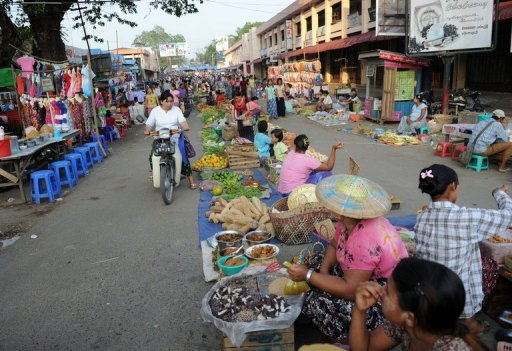 Residents buy food at a market in the town of Myitkyina