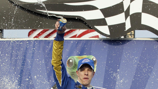 Brad Keselowski celebrates in victory lane with his crew after winning the NASCAR Sprint Cup Series auto race at Chicagoland Speedway in Joliet, Ill., Sunday, Sept. 16, 2012. (AP Photo/Nam Y. Huh)