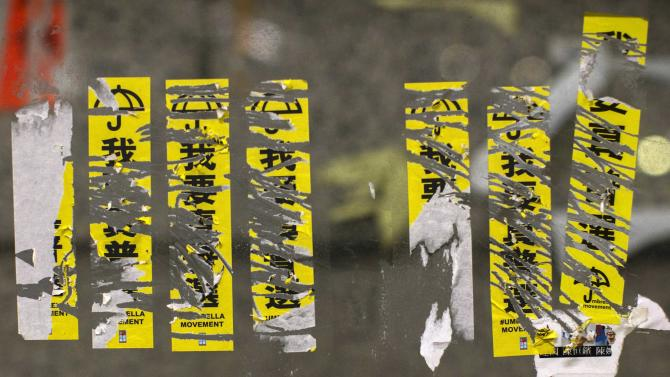 "Torn stickers are pictured at the main ""Occupy"" protest site at Admiralty in Hong Kong"