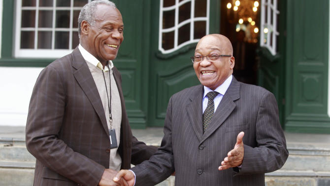 American actor and activist Danny Glover, left, reacts with South African President Jacob Zuma after a meeting in Cape Town, South Africa, Wednesday, May 29, 2013. Danny Glover made a courtesy call to South African President Jacob Zuma as part of his visit, to South Africa as a delegation member, of the United Automobile Workers Union of America. (AP Photo/Schalk van Zuydam)