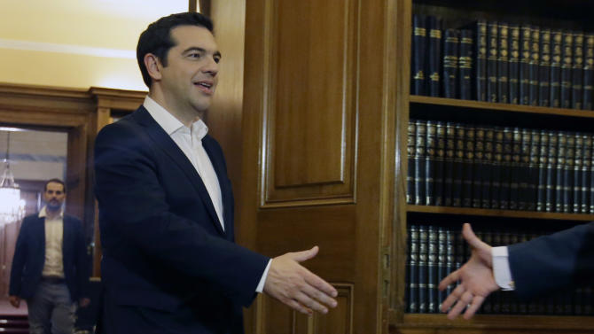Greece's Prime Minister Alexis Tsipras arrives to meet Greek President Prokopis Pavlopoulos after the results of the referendum at the Presidential Palace in Athens, early Monday, July 6, 2015. Voters in Greece resoundingly rejected creditors' demands for more austerity in return for rescue loans Sunday, backing Prime Minister Alexis Tsipras, who insisted the vote would give him a stronger hand to reach a better deal. (AP Photo/Thanassis Stavrakis)