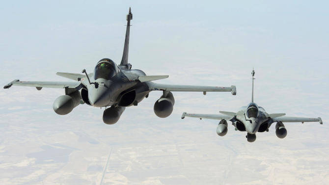 Two French Rafale fighter jets fly on a reconnaissance mission over Iraq after taking off from the Al-Dhafra base in the United Arab Emirates on September 15, 2014