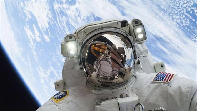 Astronaut Mike Hopkins, Expedition 38 Flight Engineer, is shown in this handout photo provided by NASA as he participates in the second of two spacewalks which took place on December 24, 2013, released on December 27, 2013. REUTERS/NASA/Handout via Reuters
