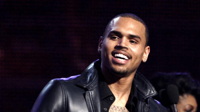"""FILE - In this Feb. 12, 2012 file photo, Chris Brown accepts the award for best R&B album for """"F.A.M.E."""" during the 54th annual Grammy Awards in Los Angeles. A Los Angeles County Sheriff's Department spokesman said Monday Feb. 4, 2013, that the agency expects to close its investigation into a fight between Brown and Ocean last month due to online comments Ocean recently posted stating he was not interested in pressing charges against Brown. (AP Photo/Matt Sayles, File)"""