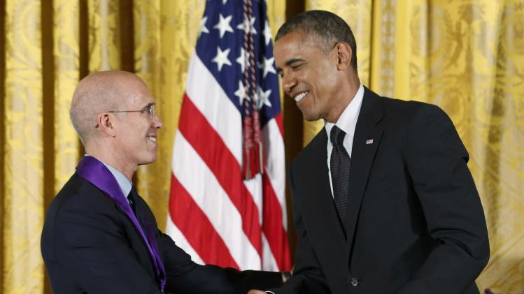 U.S. President Barack Obama congratulates DreamWorks CEO Katzenberg during a National Medal of Arts ceremony in the East Room at the White House in Washington