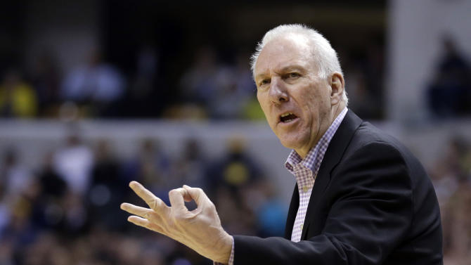 In this March 31, 2014 file photo, San Antonio Spurs head coach Gregg Popovich looks for a three second call in the first half of an NBA basketball game against the Indiana Pacers in Indianapolis. Popovich has been named NBA coach of the year, making him just the third coach in league history to win the award three times in his career.  The NBA announced the honor on Tuesday, April 22, 2014