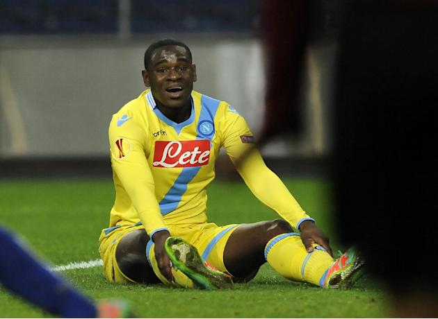 Napoli's Duvan Zapata reacts after missing a shot against FC Porto during their Europa League round of 16, first leg soccer match at the Dragao stadium, in Porto, Portugal, Thursday March 13, 2014