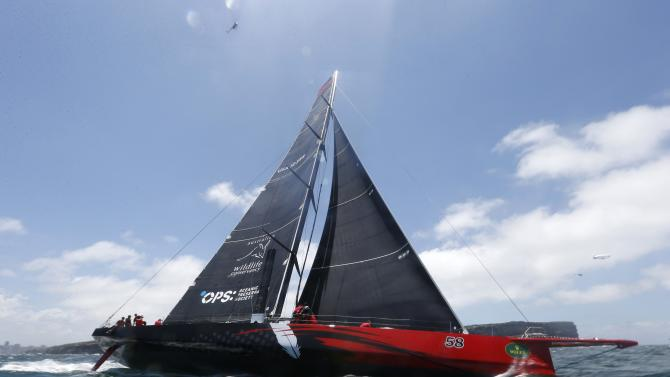 Comanche races out of Sydney Harbour into the Pacific Ocean at the start of the Sydney to Hobart Yacht Race