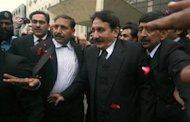 Supreme Court Chief Justice Iftikhar Chaudhry is escorted to his offices in Islamabad March 24, 2009. REUTERS/Faisal Mahmood