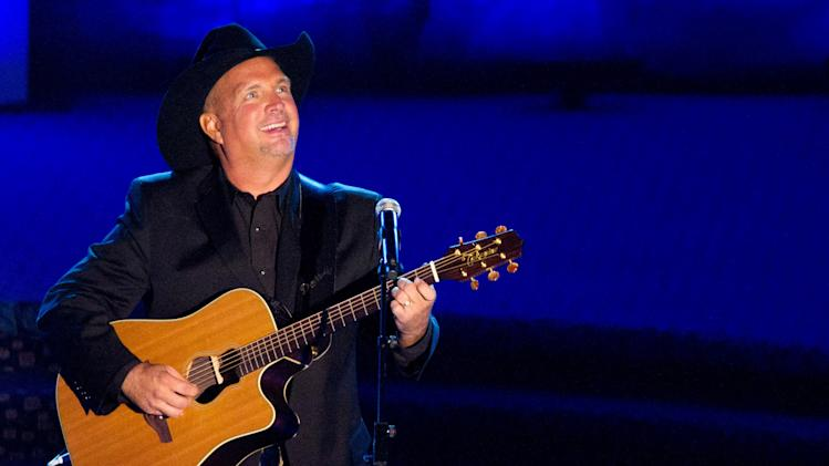 "FILE - This June 16, 2011 file photo shows inductee Garth Brooks performing onstage at the 42nd Annual Songwriters Hall of Fame Awards in New York. In stores Thursday, Nov. 28, 2013, is Brook's ""Blame It All On My Roots,"" eight-disc box set containing a blast of newly recorded material. Brooks heads up a concert special Friday, Nov. 29, 2013, that CBS will broadcast live from the Wynn resort in Las Vegas.(AP Photo/Charles Sykes, File)"