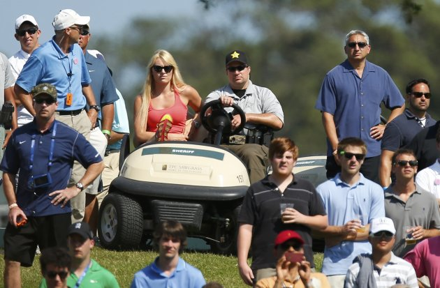 Skier Lindsey Vonn, girlfriend of Tiger Woods, sits in a golf cart watching the final round of The Players Championship in Ponte Vedra Beach