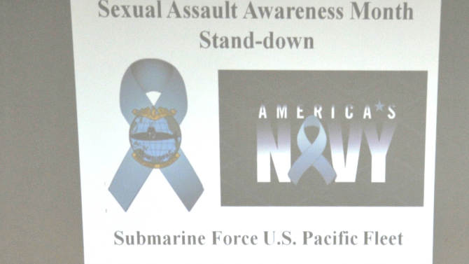 In this Friday April 6, 2012 photo provided by the US Navy Rear Adm. Frank Caldwell, commander of Submarine Force, U.S. Pacific Fleet, delivers remarks during a sexual assault awareness event at Sharkey Theater at Pearl Harbor-Hickam base in Hawaii. The event emphasized that sexual assault prevention is everyone's duty and promoted April as Sexual Assault Awareness Month. (AP Photo/U.S. Navy photo, Mass Communication Specialist 2nd Class Ronald Gutridge)