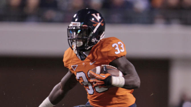 Virginia running back Perry Jones (33) hurdles a player as he gains yardage during the first half of an NCAA college football game at Scott stadium  Thursday, Nov. 15, 2012 in Charlottesville, VA ( P Photo/Steve Helber)
