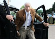 "File picture shows former Penn State assistant football coach Jerry Sandusky arriving at his child sex abuse trial in June 22. Top officials at Penn State University showed ""total and consistent disregard"" for the well-being of the young victims of the pedophilia scandal, a damning independent investigation found"