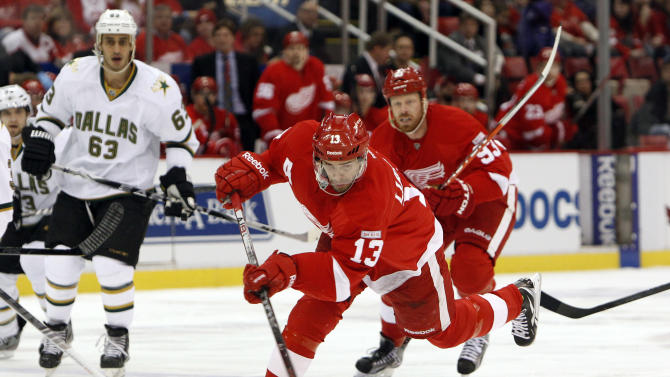 Detroit Red Wings center Pavel Datsyuk (13), of Russia, shoots against the Dallas Stars in the first period of an NHL hockey game in Detroit, Tuesday, Feb. 14, 2012. (AP Photo/Paul Sancya)