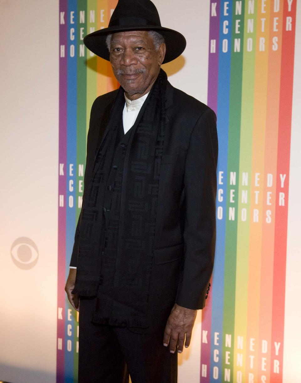 Former Kennedy Center Honoree Actor Morgan Freeman walks off the red carpet after arriving at the Kennedy Center for the Performing Arts for the 2012 Kennedy Center Honors Performance and Gala Sunday, Dec. 2, 2012 at the State Department in Washington. (AP Photo/Kevin Wolf)
