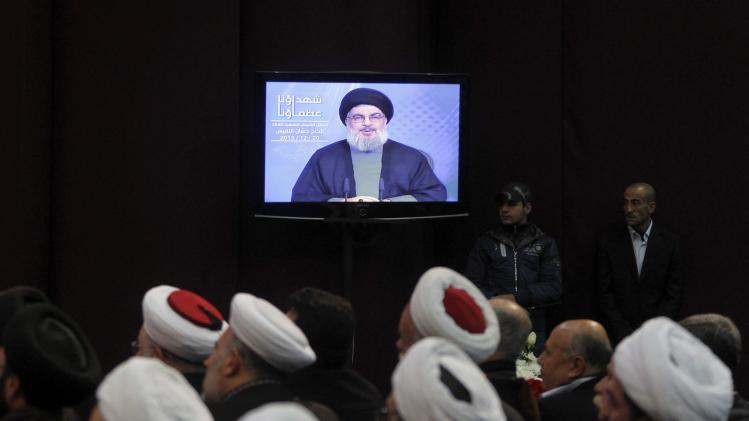Shi'ite and Sunni Muslim clerics listen to Lebanon's Hezbollah leader Nasrallah address his supporters in Beirut