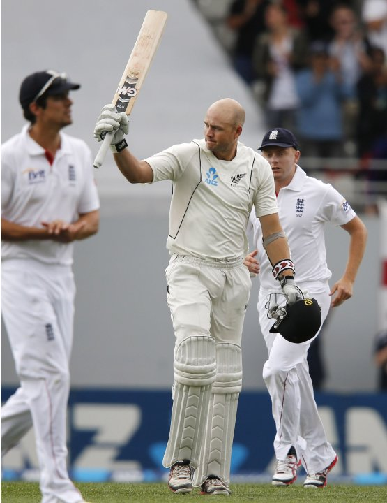 New Zealand's Peter Fulton celebrates scoring a century during day one of their final cricket test against England at Eden Park in Auckland