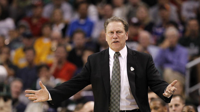 Michigan State coach Tom Izzo reacts to play in the closing minutes of an NCAA men's college basketball tournament West Regional semifinal against Louisville on Thursday, March 22, 2012, in Phoenix. Louisville won 57-44. (AP Photo/Chris Carlson)
