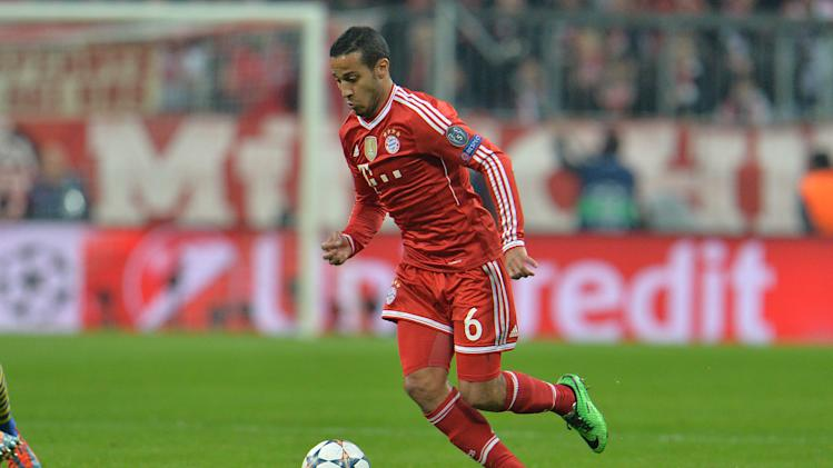 Bayern's Thiago Alcantara of Spain controls a ball during the Champions League round of the last 16 second leg soccer match between FC Bayern Munich and Arsenal FC in Munich, Germany, on Tuesday, March 11. 2014. (AP Photo/Kerstin Joensson)