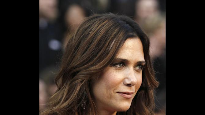 """FILE - Kristen Wiig arrives before the 84th Academy Awards on in this Feb. 26, 2012 file photo taken in the Hollywood section of Los Angeles. Wiig got a musical sendoff Saturday May 19, 2012 on the season finale of """"Saturday Night Live"""" as the versatile cast member makes her exit after seven years. Wiig starred in and co-wrote the hit comedy """"Bridesmaids,"""" and has six more films in some form of development. (AP Photo/Matt Sayles, File)"""