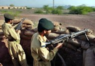 Pakistani soldiers guard a checkpoint on the outskirts of Bara in 2006. A remote-controlled bomb blast has killed eight Pakistani troops and wounded three others in a restive Pakistani tribal region near the Afghan border